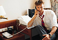 photo of man using telephone