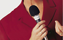Photo of a reporter with a microphone
