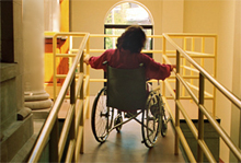 photo of woman inside a building in a wheelchair